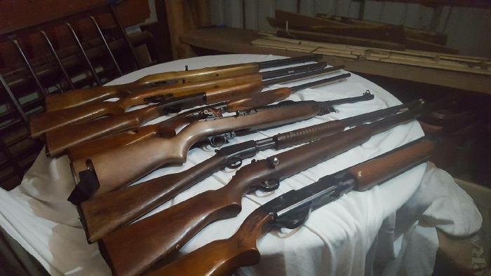 Arrest warrants leads to stolen guns, drugs