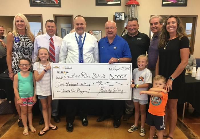 Eskridge Chevrolet makes donation for Charter Oak Elementary playground equipment