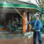 gutter cleaning wand in use