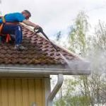 spraying debris from gutters while on the roof