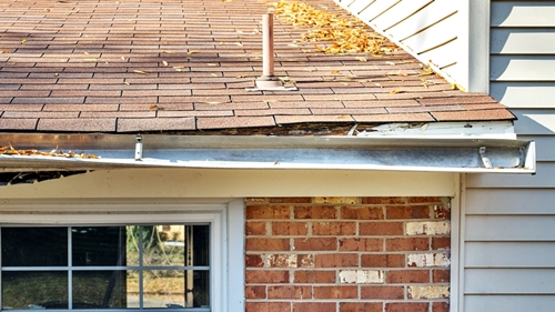 Rotten fascia board and gutter falling away from roof line gutter king wichita cleaning