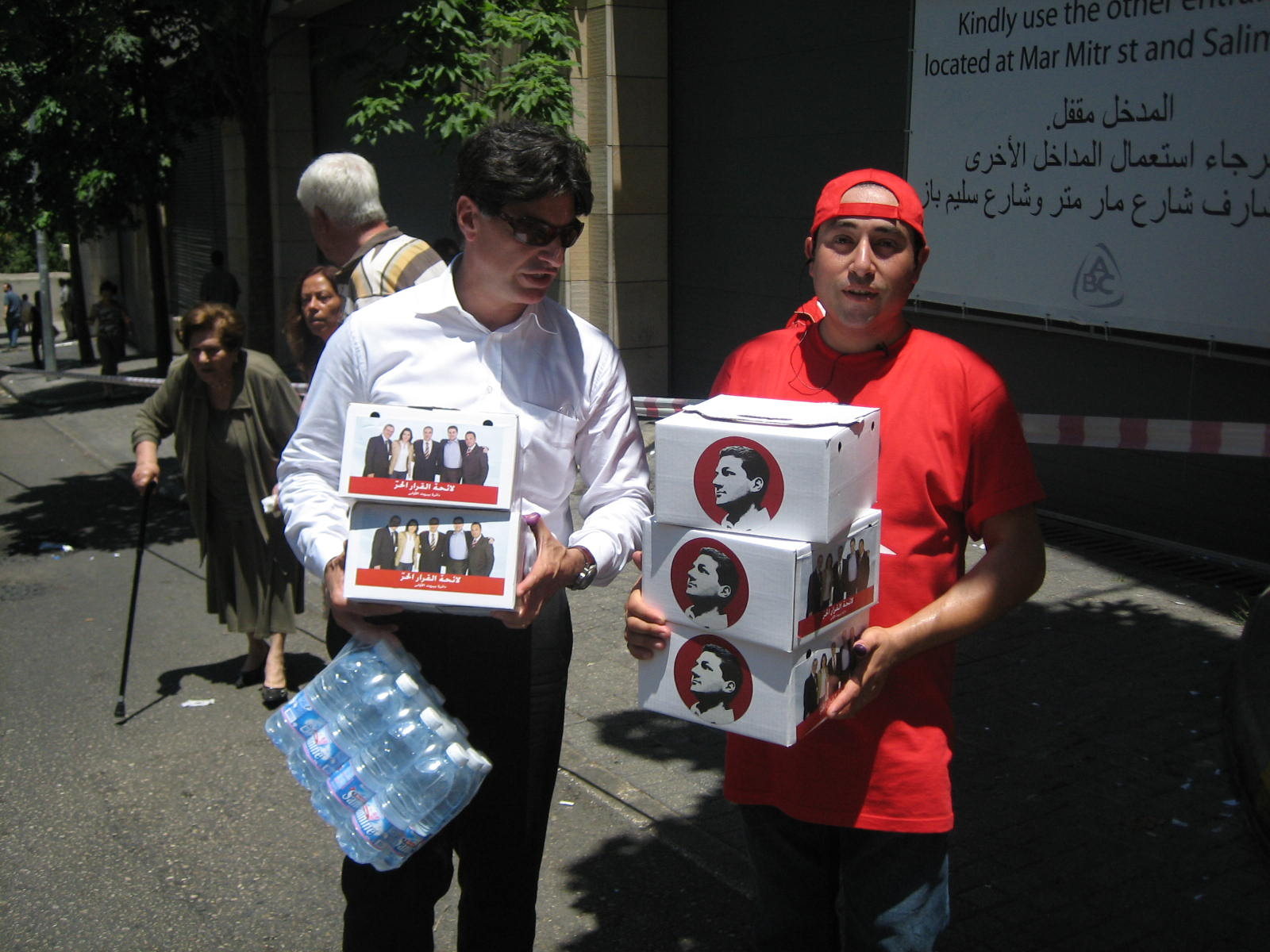 stationMarch 14 supporters hand out lunchboxes bearing the images of the coalition's candidates, notably an image of Nadim Gemayel highly reminiscent of civil war images of his assassinated father.