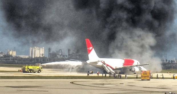 A view of the aircraft on fire during taxi at the fort Lauderdale-Hollywood International Airport