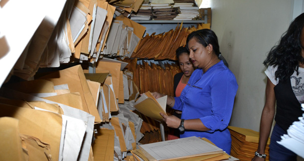 Workers inside the Deeds Registry, which still mostly uses a paper-based system