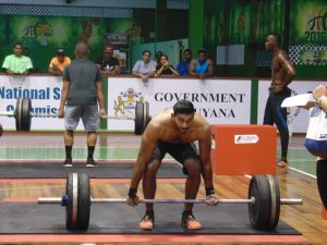 Dillon Mahadeo  competing in the box jump over and deadlifts