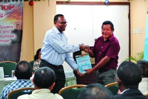 APA President, Mario Hastings (right) handing over the report to DFID's FLEGT facilitator Dr Alhassan Attah