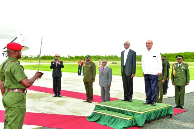 President David Granger and President Désiré Delano Bouterse being accorded the Guard of Honour Salute at the Eugene F. Correia International Airport
