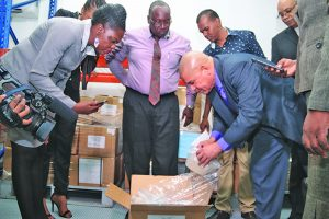 Public Health Minister, Dr George Norton along with other parliamentarians inspecting contents at the Sussex Street Bond