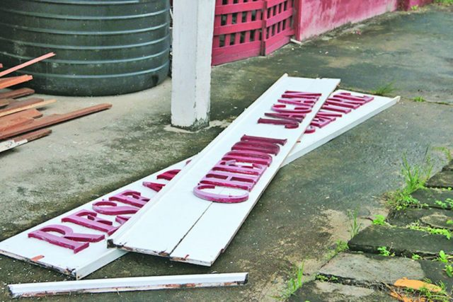 The Red House sign that was ripped down by Government officers