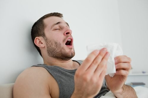 man allergies sneezing baggy eyes