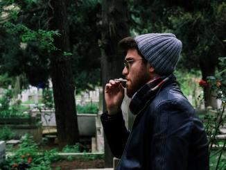 man smoking walking