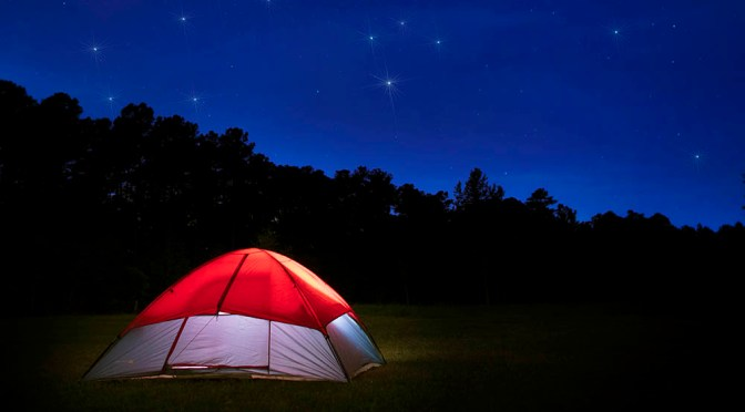 Starry night campsite, Guy J. Sagi, tent with stars shining above