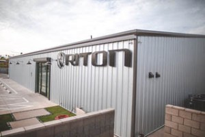 Rapid Growth Leads to Large Expansion for Riton Optics