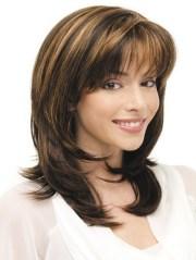 medium layered haircuts with bangs