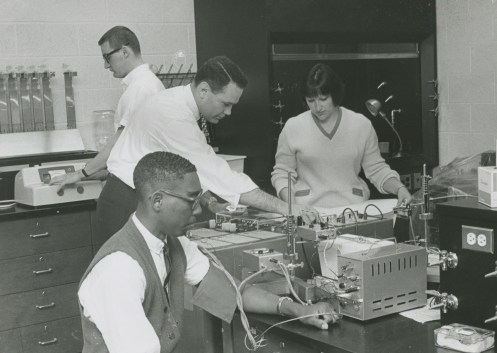 Nancy Turpin and Joe Jonston with Don Hall in physics class, 1967.