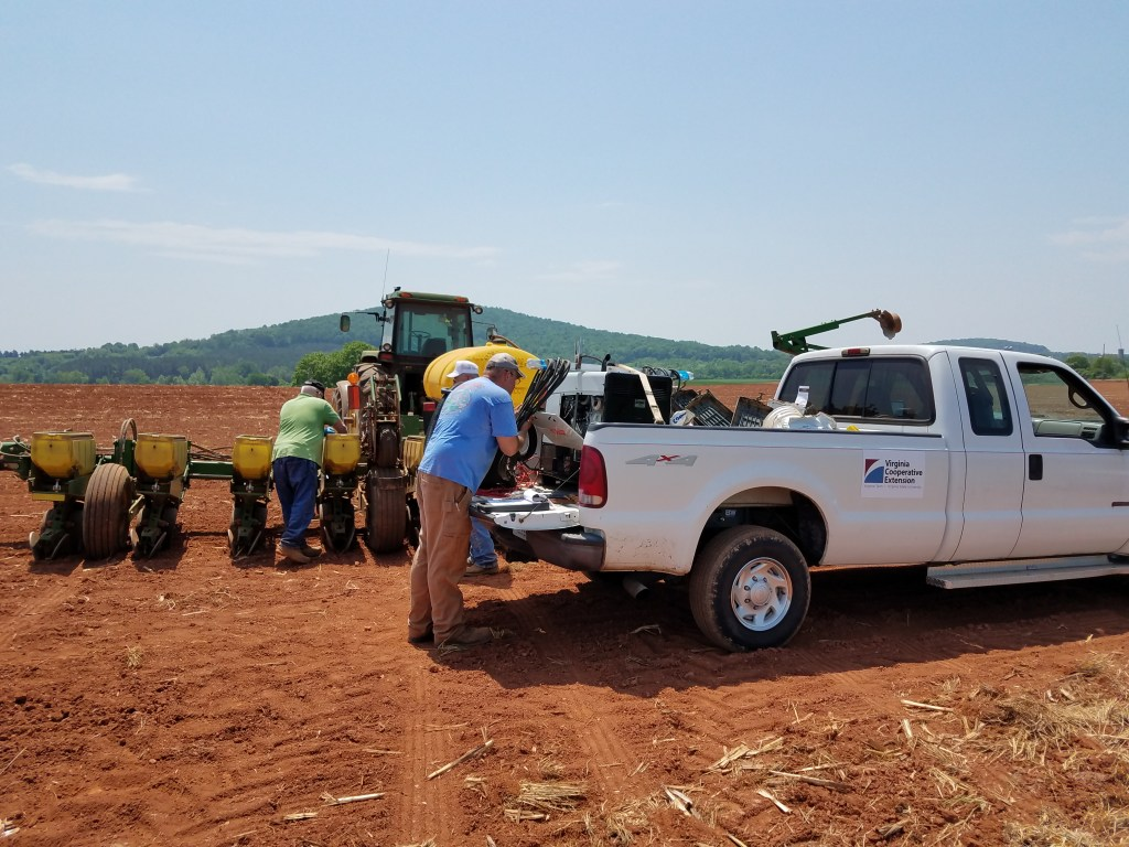 Johnathan Inskeep (foreground), Don Meek, and John Helvey complete planting of 24 corn varieties at Battle Park Farms, Culpeper County VA, 5/14/18.