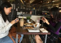 """Mushuang Wu and Ci Rem, also students at BU, thought their meal was Instagram-worthy. """"We've wanted to come here for a long time,"""" Rem said. """"Now I have time because it's a long weekend!"""""""