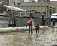 Visitors had little concern for the chilly water and drizzling rain as they waded through the tides, which reached almost knee deep in some areas.