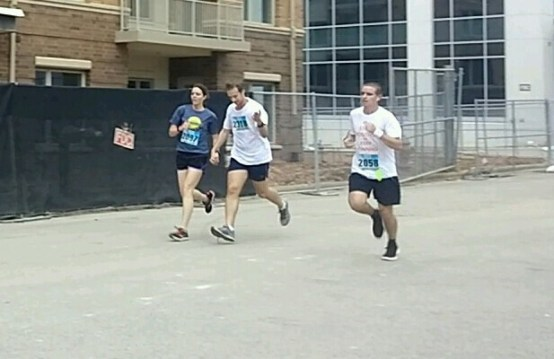 Justin overtaking this hand-holding couple at the finish.