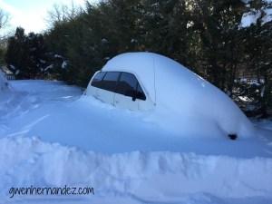 minivan covered in snow