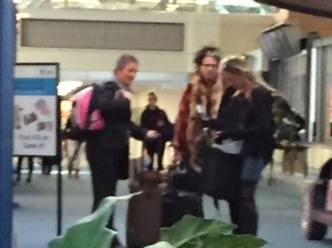 blurry photo of Steven Tyler and others at Vancouver airport