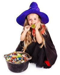 Witch  little girl with bucket of candy.