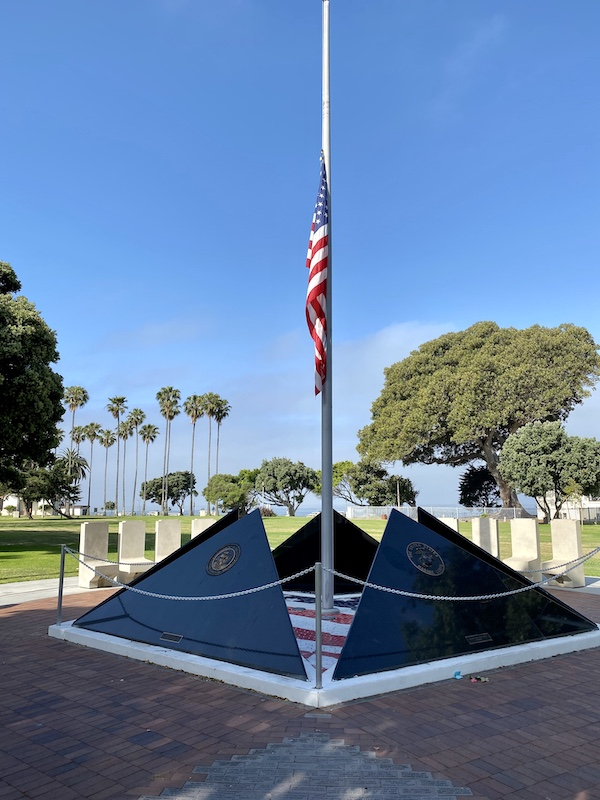 Veterans Memorial with flag at half mast