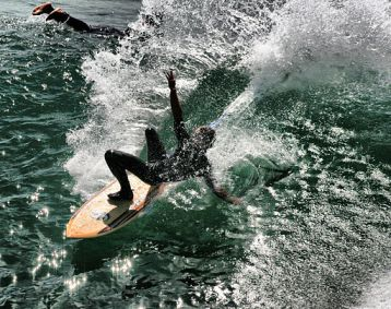 512px-Falling_surfer