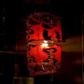 A decaying lamp in Ueno's Ameya Yokocho streets.