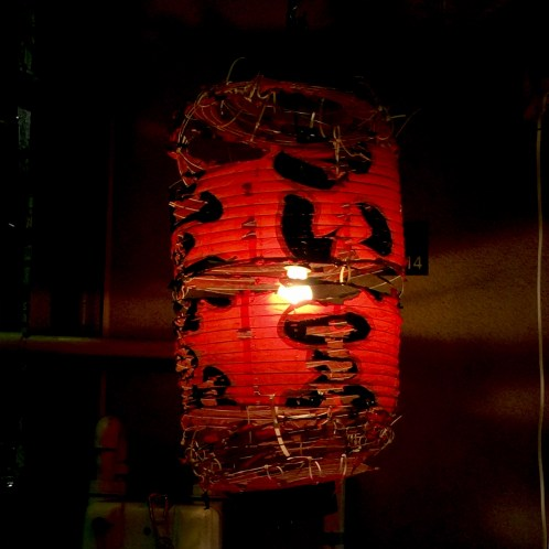 A decaying lamp in Ueno's Ameya Yokocho streets.