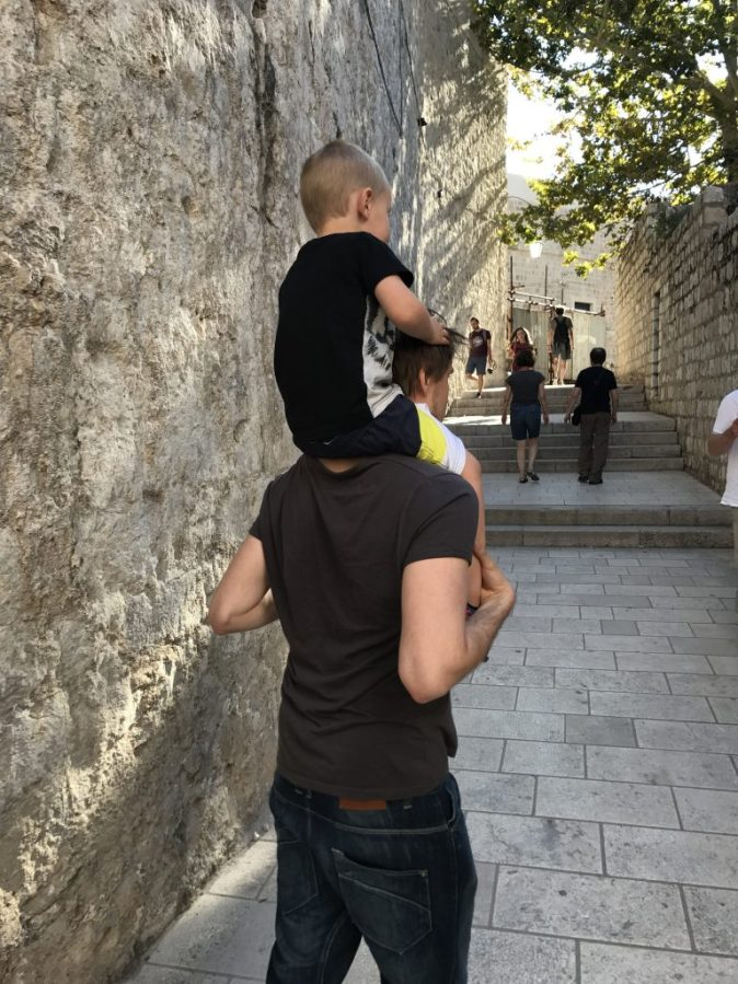 boy riding on shoulders