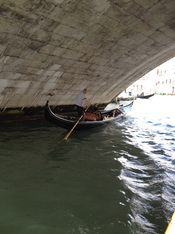 gondola under a bridge