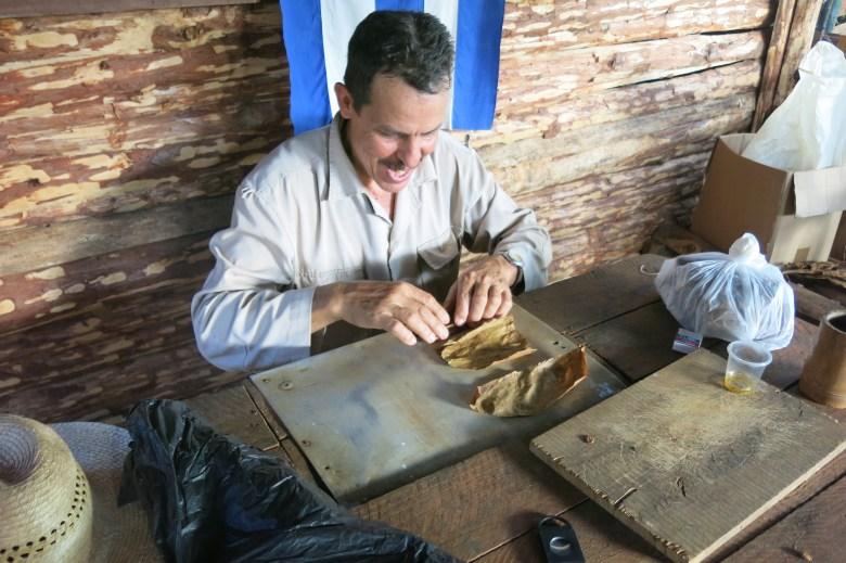 a man who rolls a cigar