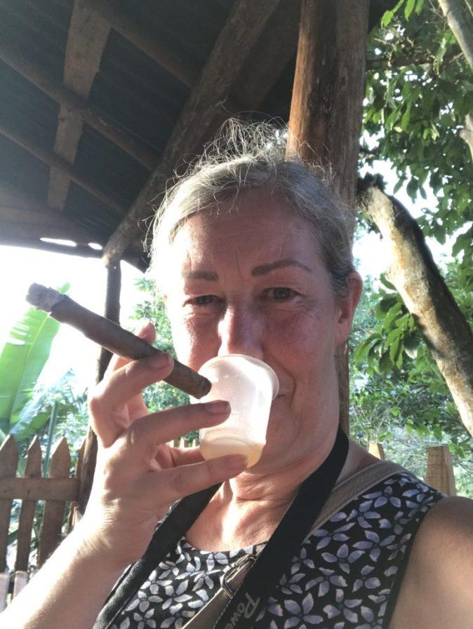 Gyllintours smokes cigar and drinks rum