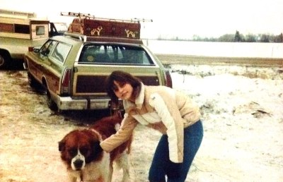 Kris with resident St. Bernard at Christmas tree farm 1979