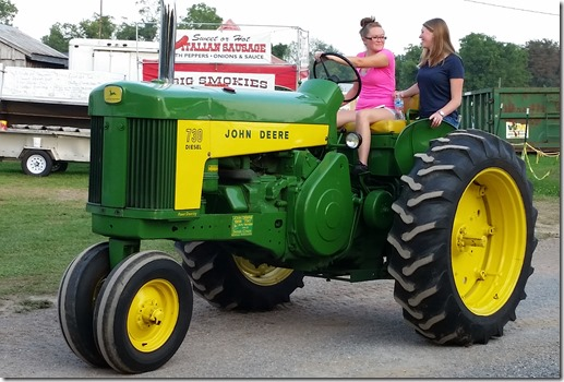 Girls drivign tractor