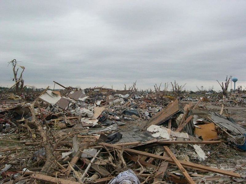 Tornado Destruction in Alabama, prompts questions about the appropriateness of travel amidst tragedy.