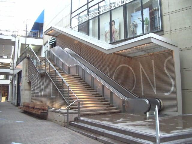 perforated metal screen wall escalator 2