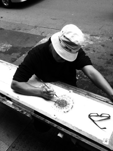 an artist drawing picture at hollywood street