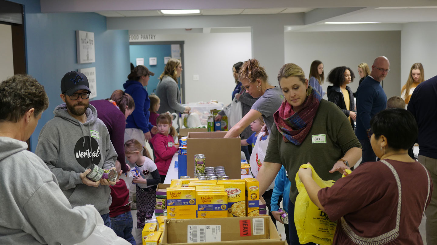 packing food in Zeeland MI for hungry children