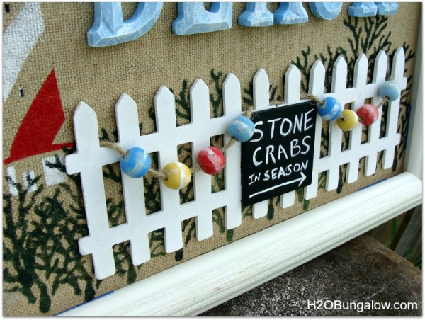 View of picket fence and crab floats on DIY beach wall art