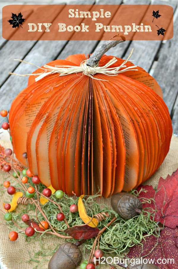Make a DIY book pumpking from an old book with sturdy pages.  Simple tutorial.  Make this in less than an hour!  www.H2OBungalow.com #halloween #falldecor #pumpkins
