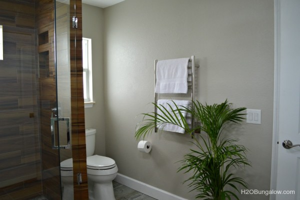 Heated-towel-rack-and touchless-Kohler-tiolet-in-contemporary-coastal-bath-renovation-H2OBungalow