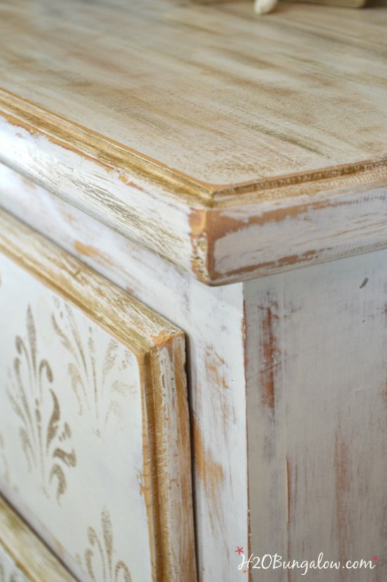 Heavily-distressed-white-and-gold-damask-stenciled-dresser-H2OBungalow
