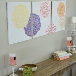 This large blooming tryptic wall art looks like it came from a gallery but it's a DIY project! Easy to make with stencils and plain canvases. H2OBungalow