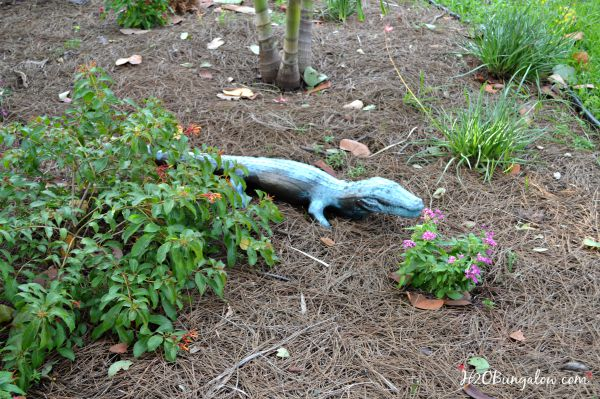 Faux painted bronze garden statue adds character to any garden spot without breaking the bank! Simple project any can do H2OBungalow.com #faux #garden #yardart