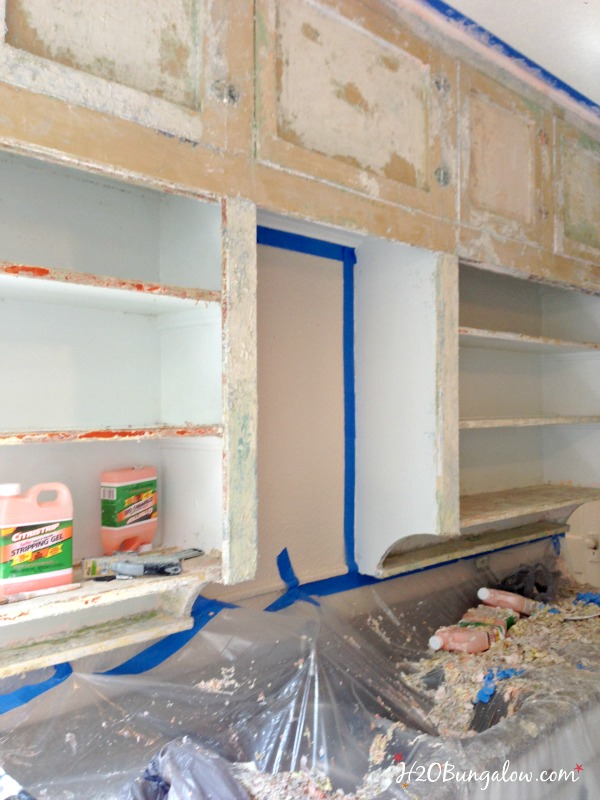 multiple-layers-of-paint-to-be-stripped-on-kitchen-cabinets-H2OBungalow