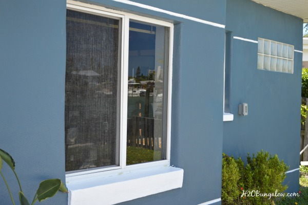 How to paint your home with a apaint sprayer using Bunglehouse Blue by Sherwin Williams