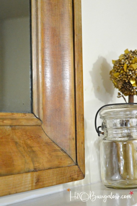 Get the Restoration Hardware look for less. Tutorial to remove veneer from wood on an old mirror exposing a natural wood patina and deconstructed style.
