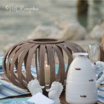 Make an upscale DIY wooden lantern that's versatile enough to use indoors or outside. Pop in a tall glass candle holder and candle or use an LED candle, either one fit's nicely with the wide top opening. Follow this easy tutorial to make a wooden lantern or set of wooden decorative lanterns for this years summer decor. #outdoordecor #woodlantern